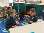 Brianna and Harrison partner read butterfly books
