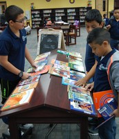 5th graders checking out books to complete Bingo