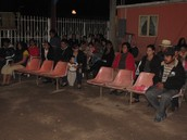 Families gathered for an outreach service