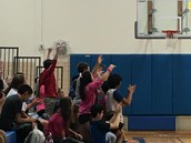 Our students cheering on our girls basketball team.