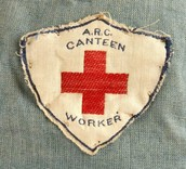 Pin that has the american red cross symbol