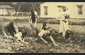 A family working in their very own Victory Garden