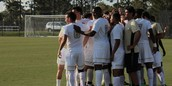 UCF soccer team huddles before a game