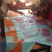 Fourth graders working on an authentic learning experience: Posters for the SOL Celebration Dance.