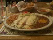 Queso (Gallo) On an enchillada , rice and beans