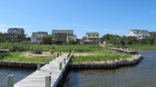 A dock and homes in the Pamlico Sound
