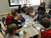 Working on our homecoming signs with our kindergarten buddies.