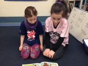 Noa and her buddy enjoying a book