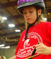 Ranch Rider, Abby, concentrating on riding around the arena.