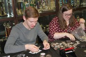 Nathan Chastik and Brin Lawrence make buttons with students with AODA button machines.