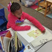 Building Words but tapping and sounding out words!