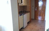 This is the kitchen it is a small sized 34x56