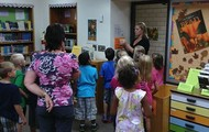 Elementary students check out the library