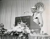 Jesse Owens giving a speech