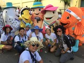 A pose with our mascots right before the Grand Parade started