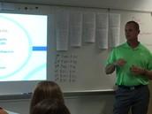 Mr. Lassiat discusses course content