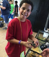 Holding a baby Red-Eared Slider in the Turtle Barn