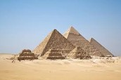 Why were the pyramids built in like a triangle?