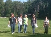 Teachers walking the grassy knoll at Camp T!