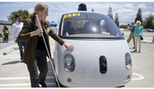 Jessie Lorenz touching the self driving cars