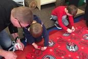 Tying a blanket for Children's Hospital