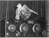 1923- Women lying on radio at a convention