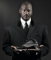 Michael Jordan holding his shoes