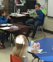 Hunter McCutchen, first grade guest reader in Ms. Kate's classroom.