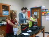 Students enjoyed unpacking and setting up their Chromebooks in the cases.
