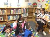 Mrs. Lucio reads to Kindergarten