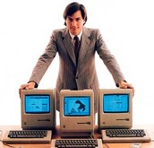 Young Steve Jobs with the Macintosh