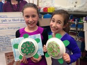 Noa and Abby showing off their project from Marcus' Poet of the Week project