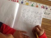First grader in Ashley Nemo's class writing in math (communication process goal)