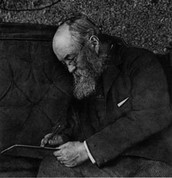 Olmsted sitting on his bed wrighting in his journal. (was a journalist when he was younger)