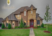 Beautiful Custom Two Story Lakeside Home with 3803 Square Feet, 4 Bedrooms, 3.1 Bathrooms and a 2+1 Garage, located in The Lakes At Traditions Community in Edmond