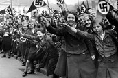 German Girls holding flags with the symbol of germany.