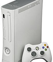 White Xbox 360 with a wireless controller