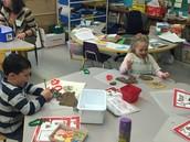 Kindergarten exploring with gingerbread playdough.