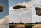 A crate being dropped in via heavy duty parachutes