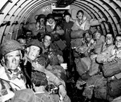 paratroopers preparing for jump the morning before D-Day