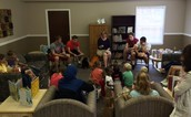 WL football team reads with students during mobile library