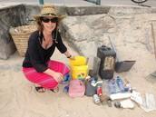 Mrs Harrison (2A) cleaning her beach in Lamma