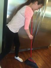 Me sweeping the floors