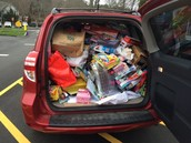 An SUV full of toys being donated by MMES to Pathways for Children!