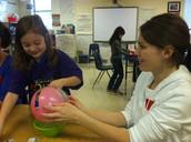 Kate creating her paper mache' globe