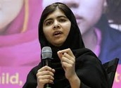 Malala giving a speech on her journey