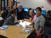 Kids working on Karana poster.