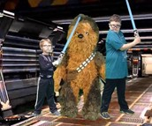 Brendan and his friend Liam pose with Chewbacca