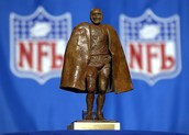 Why is there a Walter Payton man of the year award?