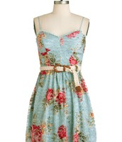 Blue dress with red flowers